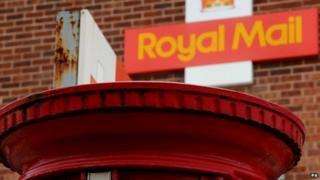 Royal Mail sign and post box