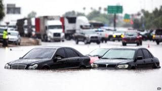 Cars flooded on a highway in Arizona