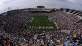 College football fans watch an NCAA college football game between the Penn State and the Akron at Beaver Stadium in State College, Pennsylvania 6 September 2014