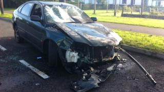 Burnt out car in Racecourse Road
