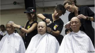 Founders of the Occupy Central movement (from L to R), academic Chan Kin-man, academic Benny Tai and Reverend Chu Yiu-ming, shave their heads during a protest to call for people to join them for an upcoming rally in Hong Kong (9 September 2014)