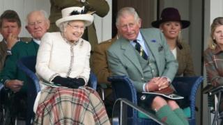 Queen Elizabeth II and Prince Charles, Prince of Wales watch the Braemar Highland Games 2014