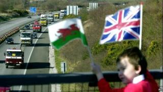 Boy waving Welsh and union flag