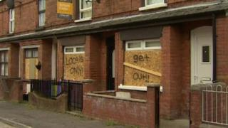 Home of a Eastern European woman in Belfast, with racist graffiti