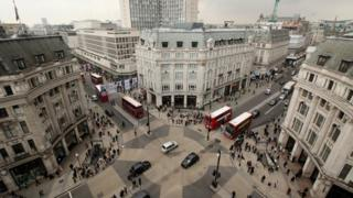 Cars and buses at the junction of Oxford Street and Regent Street