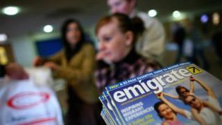 Britons visit an emigration exhibition