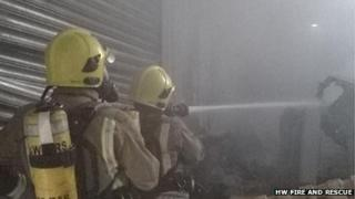 Firefighters in burning paper works