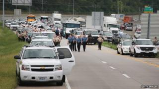 Police vehicles fill an off ramp along Interstate Highway 70 as they try to prevent demonstrators from entering the highway on September 10, 2014 near Ferguson, Missouri