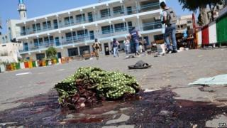 A piece of cloth lies in a pool of blood outside a UN-operated school after an Israeli attack in Beit Hanoun in northern Gaza - 24 July 2014