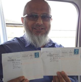 Ismail Patel holding the letters