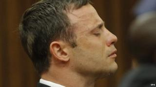 South African Paralympic athlete Oscar Pistorius cries while the verdict is being read during the verdict in his murder trial, Pretoria, South Africa, 11 September 2014