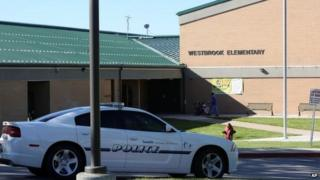 A police car is parked in front of Westbrook Elementary School in Taylorsville, Utah, 11 September 2011