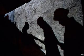 Projected images of soldiers' figures in new IWM trenches display
