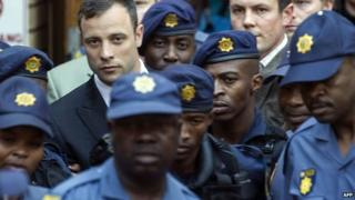 South African Paralympian athlete Oscar Pistorius leaves the the High Court in Pretoria on 12 September 2014