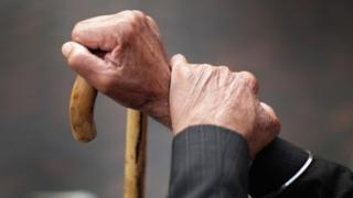 A pensioner holds his walking stick in September 2014 in Walsall
