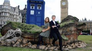 "Peter Capaldi and Jenna Coleman attend a photocall ahead of the new BBC series of ""Dr Who"" in Parliament Square in August 2014"