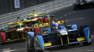 E.Dams-Renault driver Nicolas Prost of France takes the lead in the Formula E Championship race in Beijing 13/09/2014