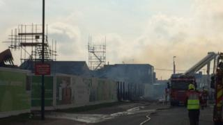 Fire crews dampen down after the blaze