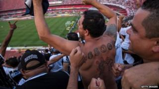 Corinthians fan celebrates against Sao Paulo