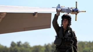 A member of Australia's Air Force carries out checks on a Super Hornet fighter jet - 11 August 2014