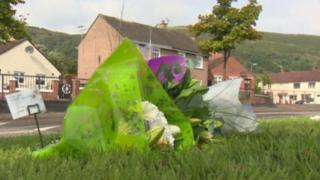 Flowers left at scene of fatal road accident