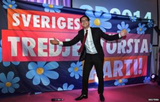 "Jimmie Akesson celebrates in front of poster saying ""Sweden's third largest party"" (14 Sept)"