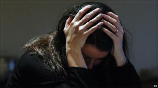Generic picture of woman in despair