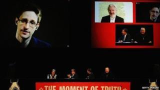 Edward Snowden, Julian Assange, Internet Party leader Laila Harre, Robert Amsterdam, Glenn Greenwald and Kim Dotcom discuss the revelations about New Zealand's mass surveillance at Auckland Town Hall