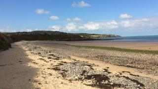 Traeth yr Ora near Moelfre on Anglesey , which is criss-crossed by the Anglesey Coastal Path