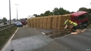 The overturned hay wagon on the M6 in Warwickshire