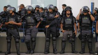 Police near the Maracana stadium on the last day of the World Cup, Sunday 13 July 2014