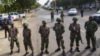 Nigerian soldiers cordon off a road leading to the scene of a blast at a business district in Abuja (June 2014)
