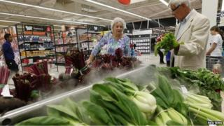 Shoppers at a Tesco Extra supermarket in Watford
