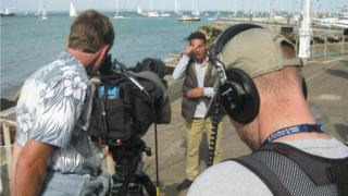 See Hear filming in the Isle of Wight. Can see the cameraman and soundman and the presenter Memnos