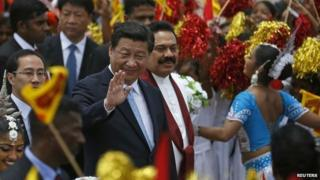 "Chinese President Xi Jinping waves next to Sri Lanka""s President Mahinda Rajapaksa during an official welcoming ceremony at Bandaranaike International Airport in Katunayake September 16, 2014."