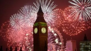 Fireworks explode over London on 1 January 2014
