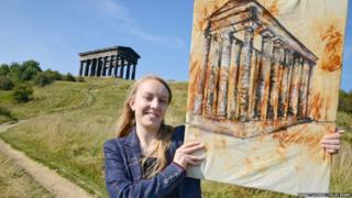 Amy Ward with a painting of the Penshaw Monument by art student Chloe Burke