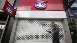 File photo dated 15/09/14 of a Phones 4U shop in Oxford Street in central London with its shutters down.
