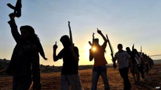 Members of Jihadist group Hamza Abdualmuttalib (in silhouette) train near Aleppo. File photo