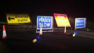 Police signs near crash scene