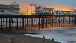 Hastings Pier on fire as dawn breaks