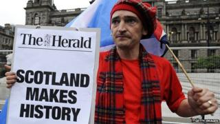 A pro-independence supporter is pictured in George Square in Glasgow, Scotland, on 19 September 2014 following a defeat in the referendum on Scottish independence.