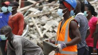 A rescue workers at the site of a collapsed building at the Synagogue Church of All Nations in the Ikotun-Egbe neighbourhood of Nigeria's commercial capital Lagos, 17 September 2014