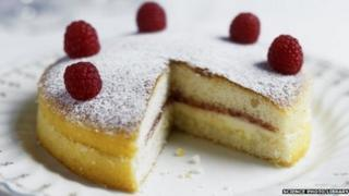 Raspberry sponge cake with slice taken out