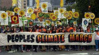Climate-change activists march through the streets of New York City on 21 September, 2014.