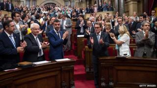 "President of Catalonia Artur Mas (3rdR) celebrates after the Catalan Parliament approved the Law allowing Catalonia""s Government to call on a self-determination referendum from Spain on September 19, 2014 in Barcelona, Spain"