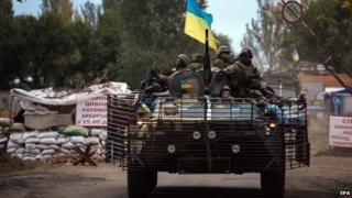 Ukrainian soldiers drive an Armoured Personnel Carrier (APC) in Kramatorsk town, Donetsk region, Ukraine, 11 September 2014