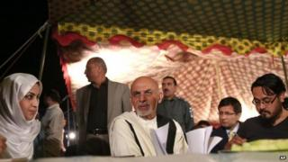Ashraf Ghani (C) talks to journalists in Kabul - 10 September
