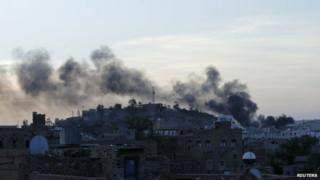 Smoke rises over Sanaa. Photo: 20 September 2014