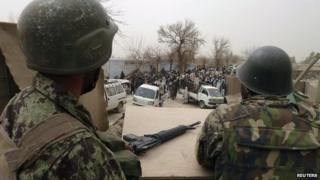 Afghan soldiers at a US base in Panjwai district, Kandahar province 11 March 2012